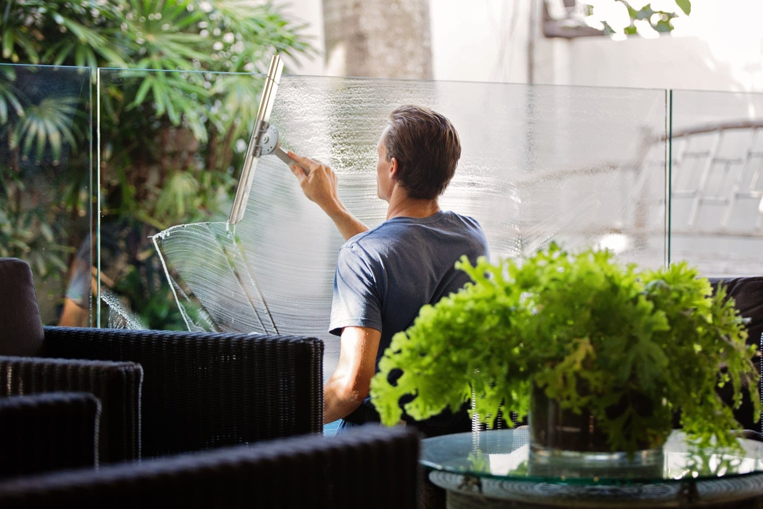 Man cleaning window