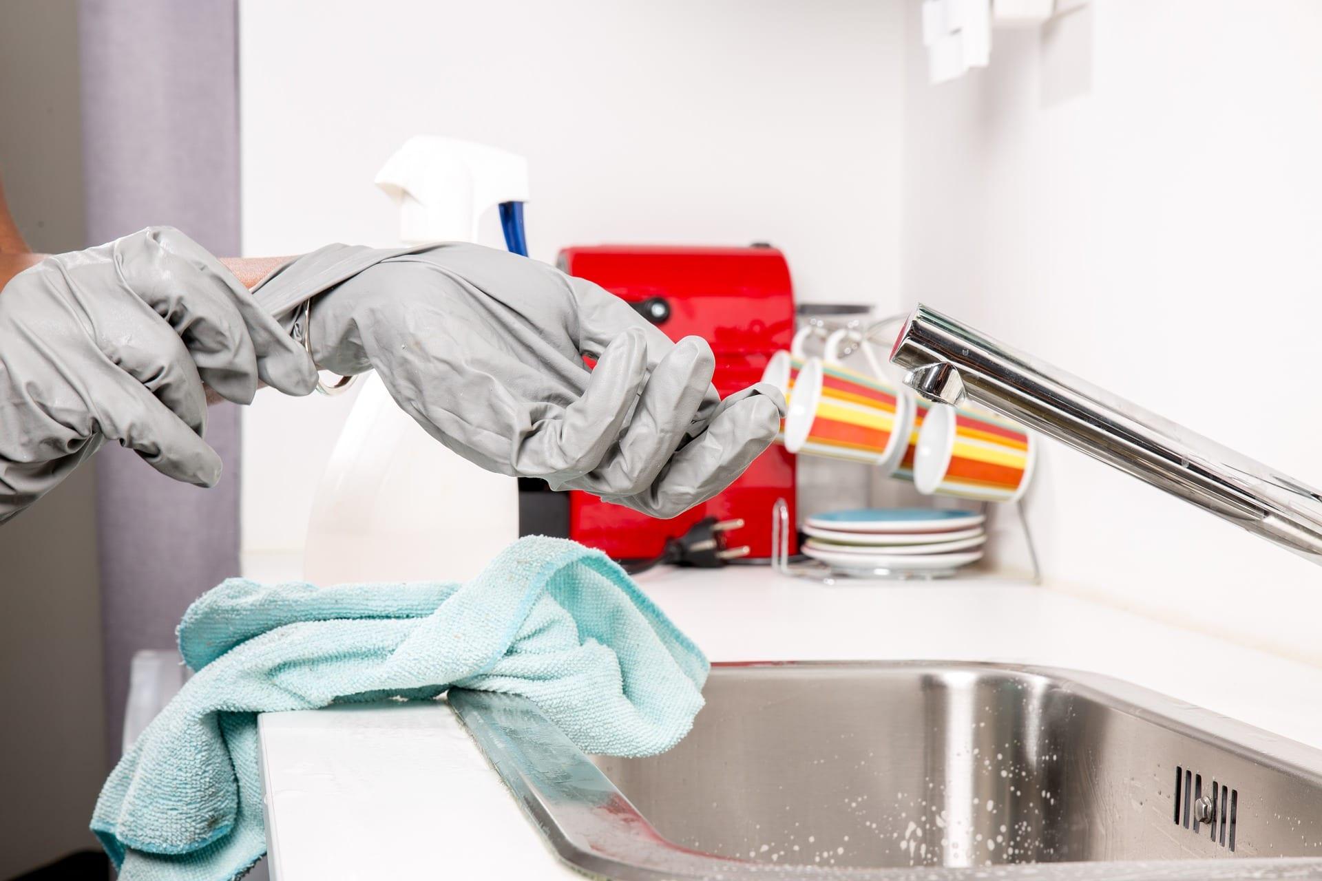 Taking off gloves next to sink