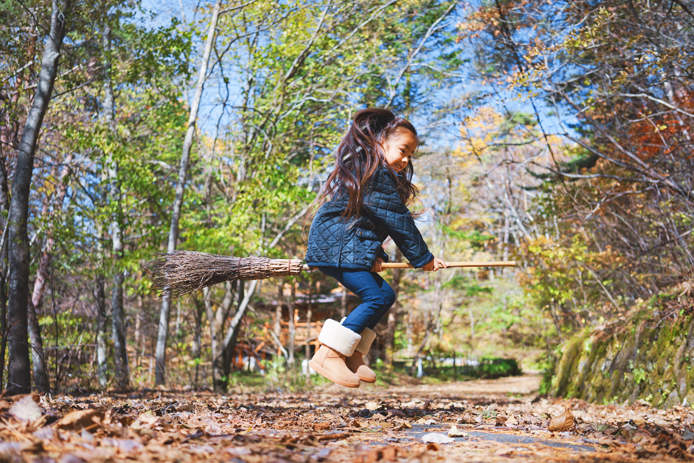 Girl flying on broom
