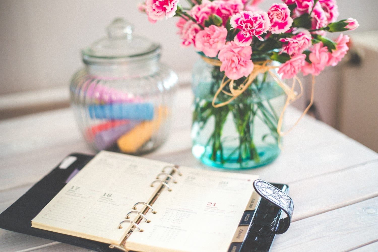 Planner and flowers on desk