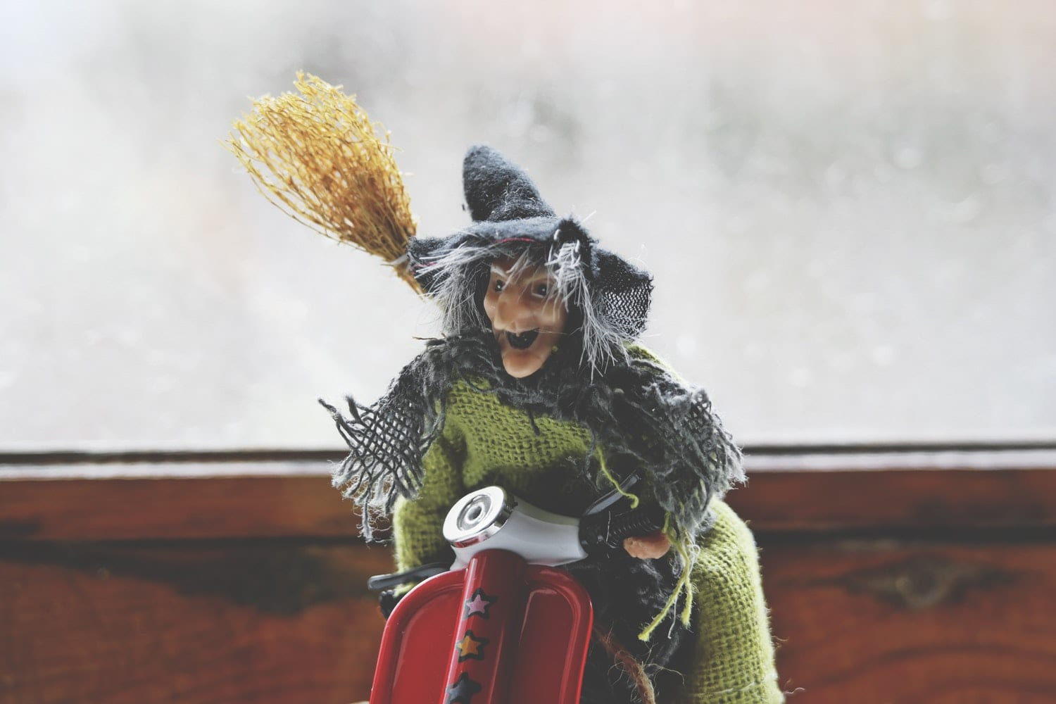 Toy witch with broom